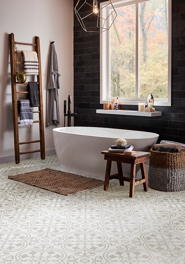 Bathroom with light colored and patterned laminate floors