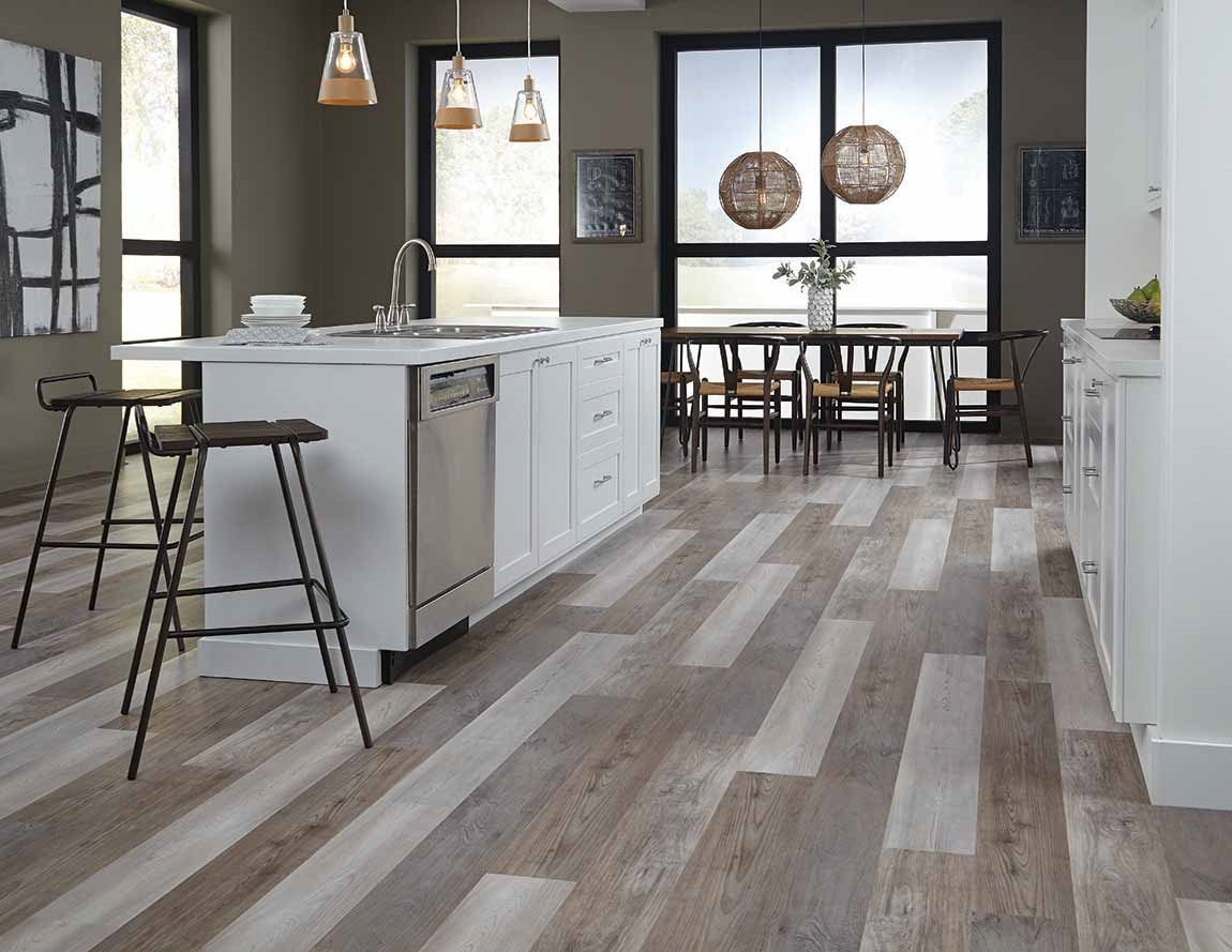 light colored luxury vinyl floor in light colored kitchen